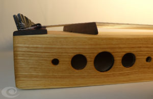 Monochord Monocorp Monocordio Ash wood, clear color, five round holes, iron top bridge, amethyst. body monochord. Almond wood tops.
